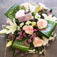 Pale pink funeral posy