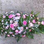 Pink colour casket spray,roses,chrysanthemums,