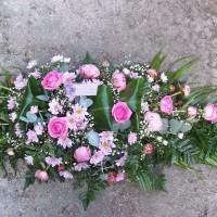 Pink colour casket spray,roses,chrysanthemums,