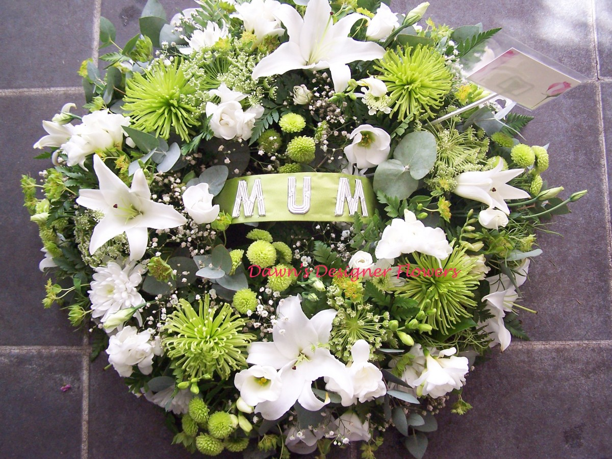 Green and white funeral wreath by Dawn's Designer Flowers