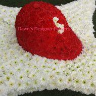 Basball cap in red , fresh flowers