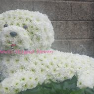 white dog from flowers